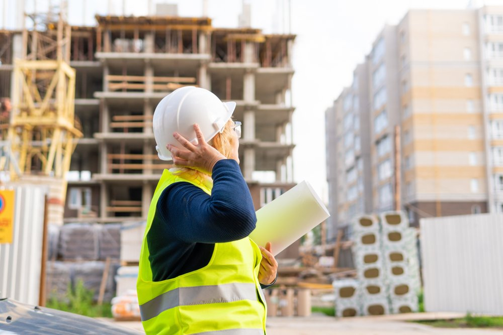 Contractor look up at a building site