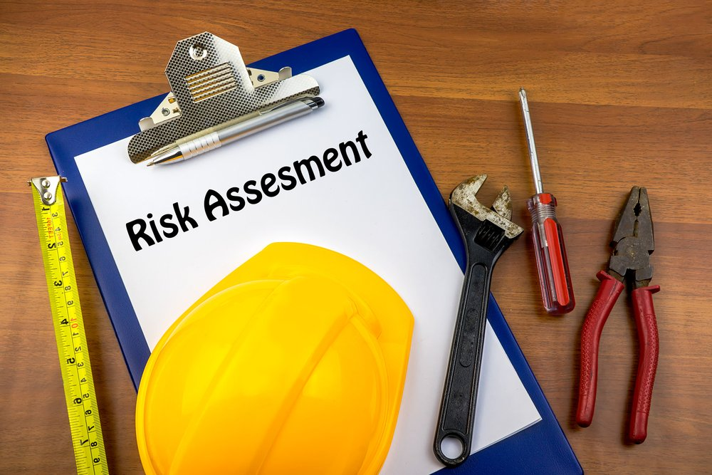 Builder hat and tools - CHAS Risk Assesment
