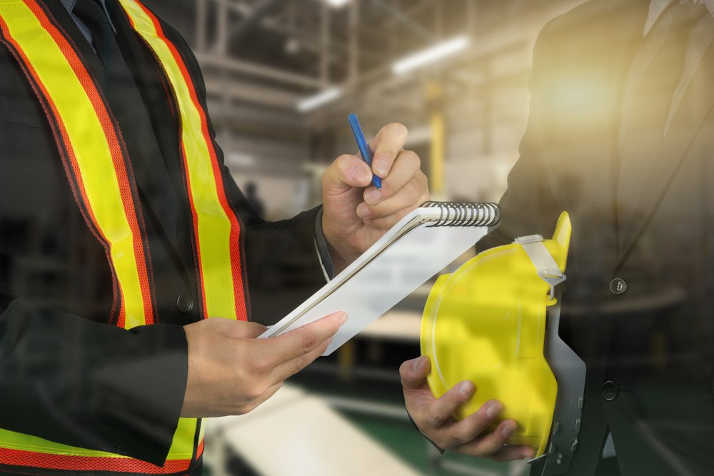 engineers at work with notepads - CHAS workplace safety