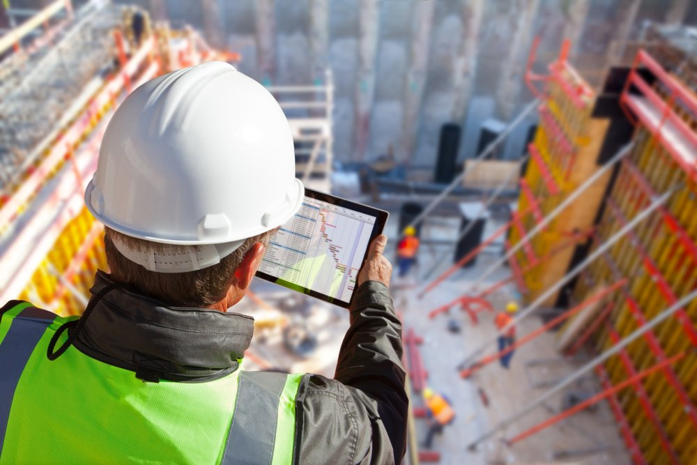 engineer overseeing construction site - chas blog