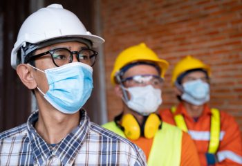 industrial engineering team wear face masks for covid-19 safety